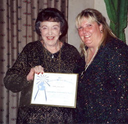 Jackie, posing with daughter Karen, holding SWG's Outstanding Achievement Award, Tuson, Arizona 2002